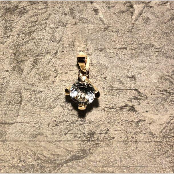 Vedhæng i 8 krt guld med topaz