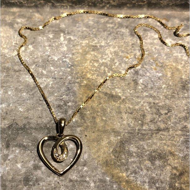 Hjertevedhæng i 14 krt guld med brillant