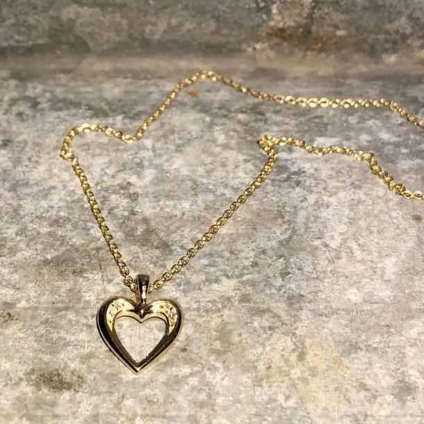 Hjertevedhæng i 14 krt guld med små brillanter